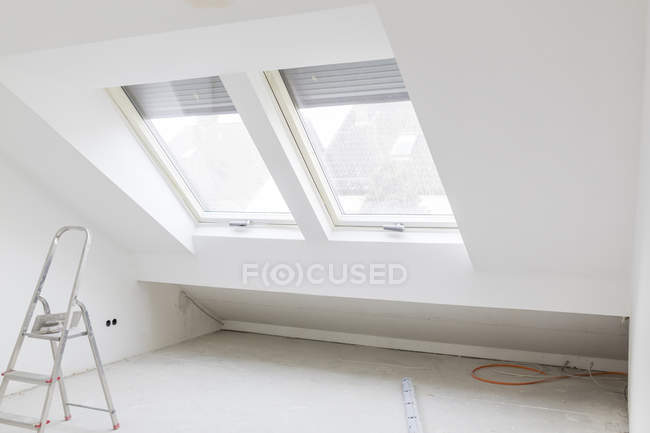 Construction site of penthouse with roof window — Stock Photo