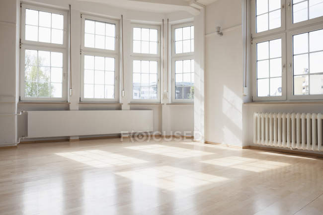 Bright empty apartment indoors during daytime — Stock Photo
