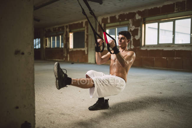 Young man exercising suspension training trx — Stock Photo