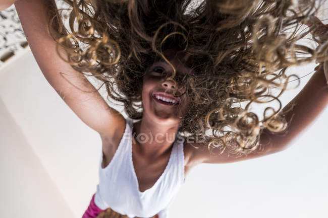 Little girl balanced on with head down — Stock Photo