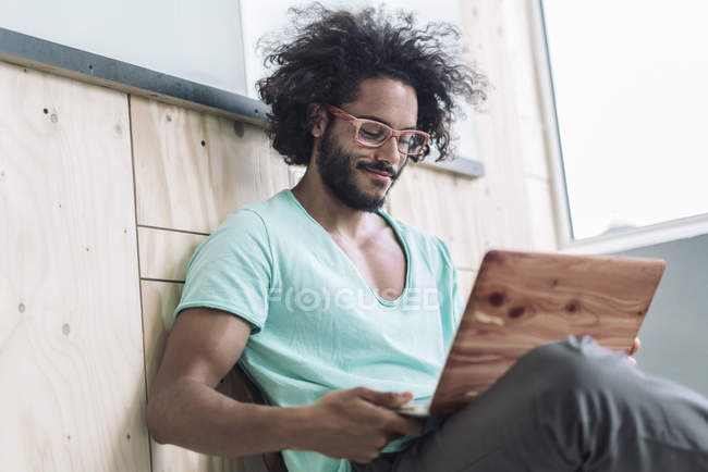 Young designer working on laptop — Stock Photo