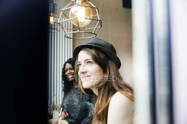 Two friends having fun in cafe — Stock Photo