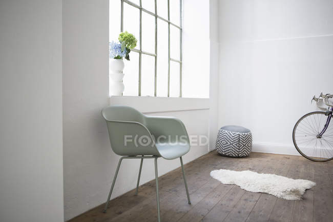 Modern home interior, chair and stool at window — Stock Photo