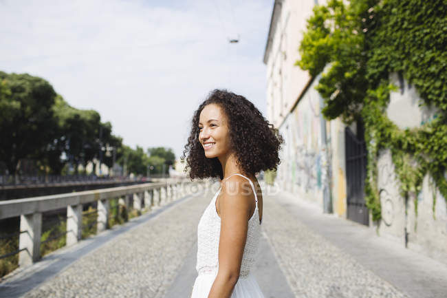Young woman with curly brown hair — Stock Photo