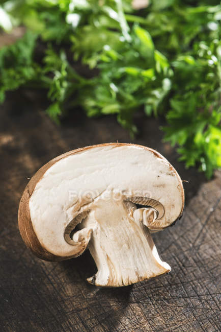 Mushrooms and herbs on wooden board — Stock Photo