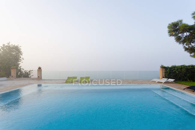 Spain, Balearic Islands, Majorca, Swimming and safety glass railing — Stock Photo