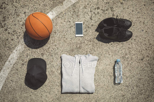 Basketball items lying on ground of basketball court — Stock Photo
