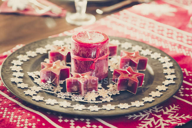 Christmas decoration on laid table — Stock Photo