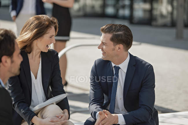 Business colleagues having fun outdoors — Stock Photo