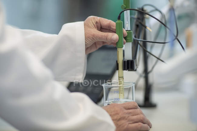 Cropped image of scientist working in lab — Stock Photo