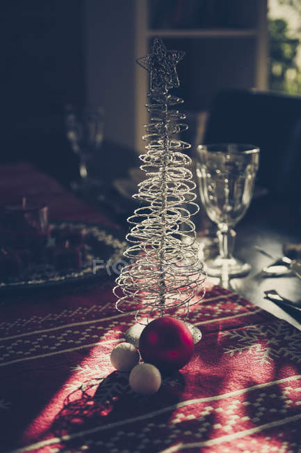 Close-up of Christmas decoration on laid table — Stock Photo