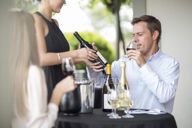 Man in restaurant tasting red wine — Stock Photo