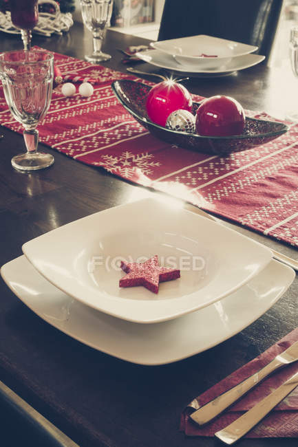 Laid dining table with Christmas decoration — Stock Photo