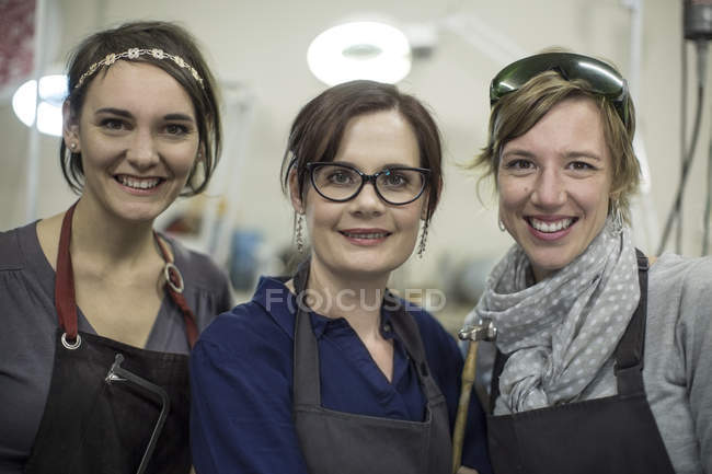 Portrait of three smiling female goldsmiths — Stock Photo