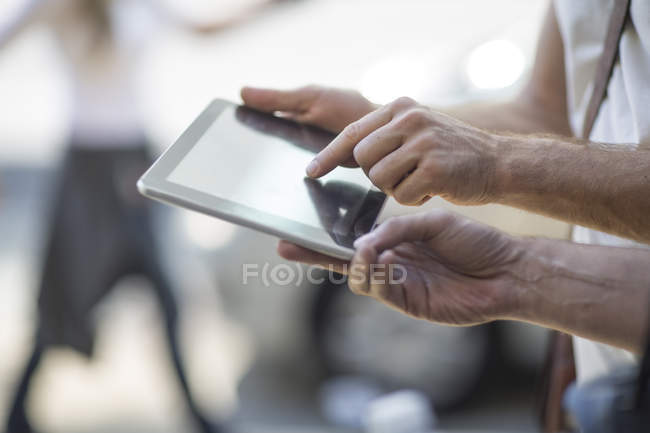 Two men sharing digital tablet outdoors — Stock Photo
