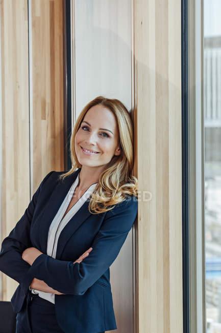 Portrait of confident businesswoman in modern office — Stock Photo