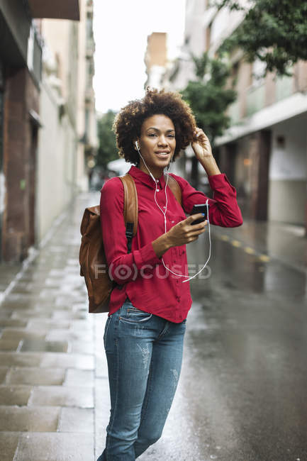 Woman listening music with earphones — Stock Photo
