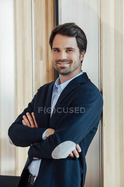 Portrait of confident businessman in modern office — Stock Photo