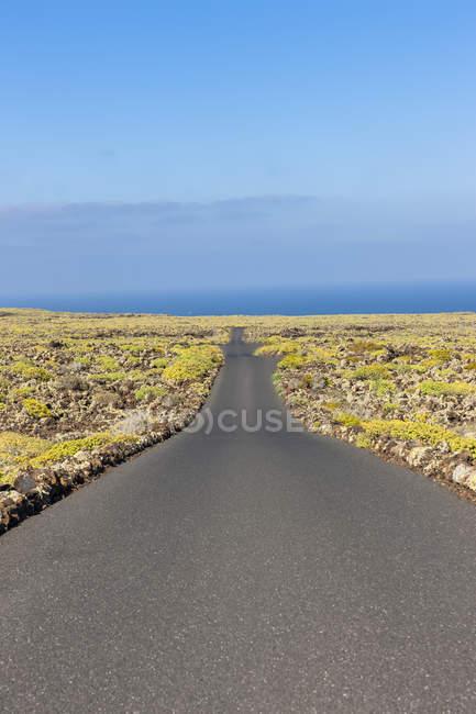 Spain, Canary Islands, Lanzarote, empty road — Stock Photo