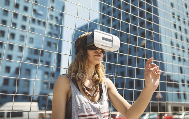 Young woman using virtual reality glasses — Stock Photo