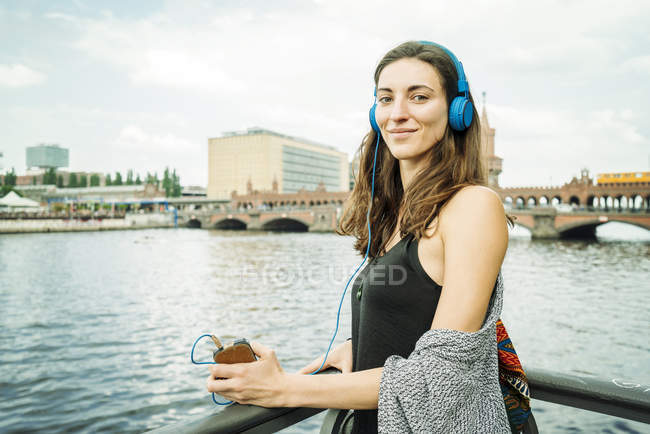 Portrait of relaxed woman listening music with headphones — Stock Photo