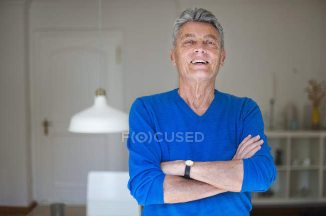 Portrait of confident senior man at home — Stock Photo