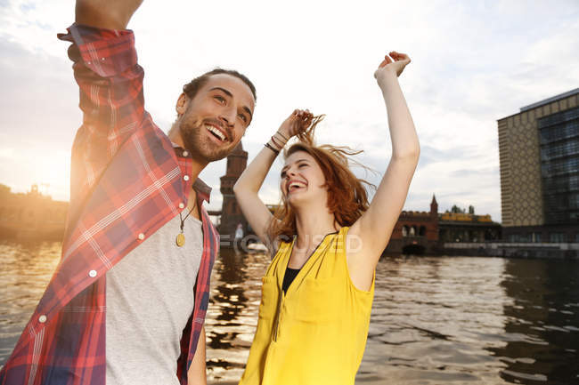Germany, Berlin, Young couple enjoying sunset at Spree river — Stock Photo