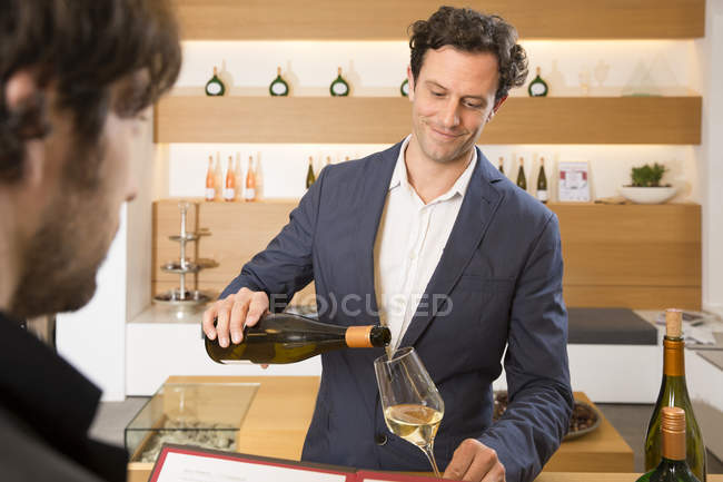 Two men tasting wine in a shop — Stock Photo