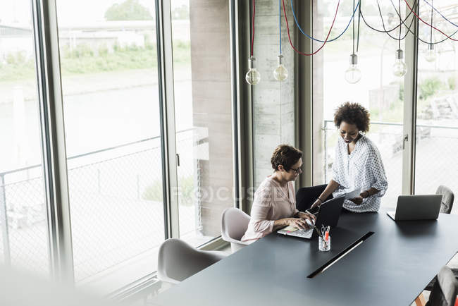 Two women working together in office — Stock Photo