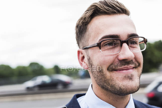 Portrait of young businessman wearing spectacles — Stock Photo