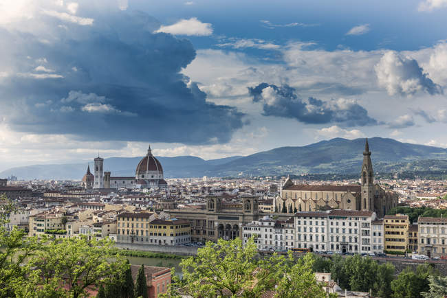 Italy, Tuscany, Florence, historic old town, Basilica of Santa Croce right, mountains on background — Stock Photo