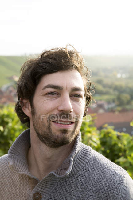 Portrait of winegrower looking at camera in vineyard — Stock Photo