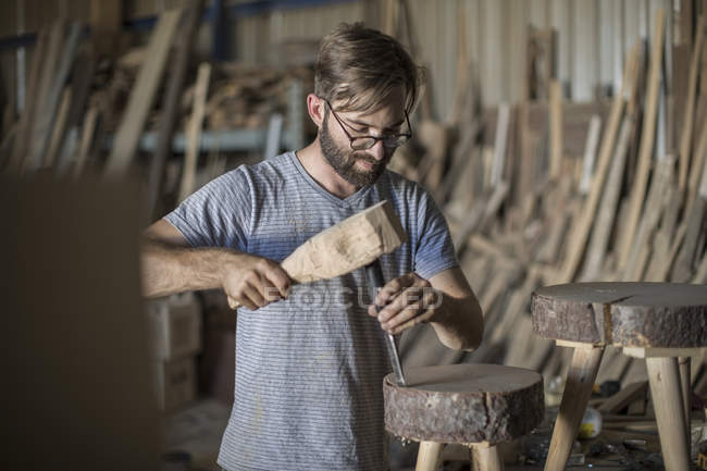 Male Carpenter using a chisel in workshop — Stock Photo