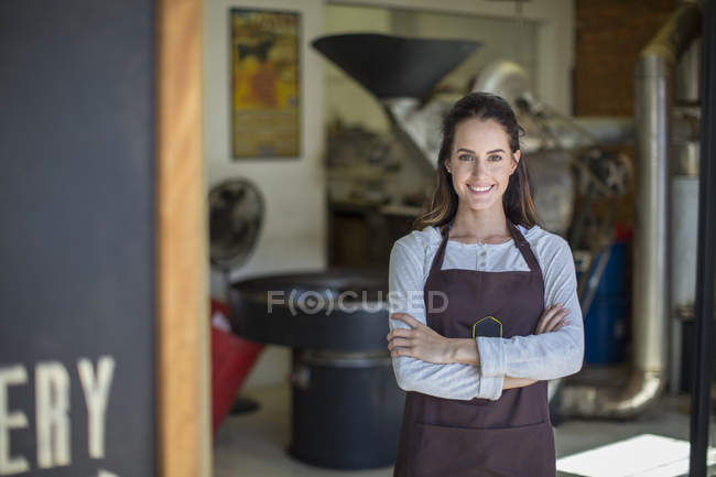 Coffee roasting shop owner in front of shop — Stock Photo