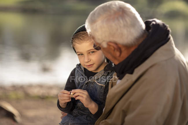 Caucasian grandfather and grandson together in park — Stock Photo
