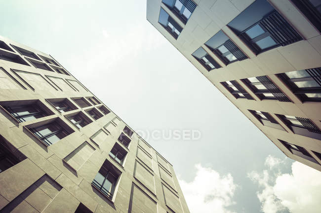 Bottom view of facades of modern office buildings at daytime, Berlin, Germany — Stock Photo