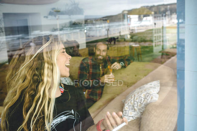 Happy couple laughing and having fun in cafe — Stock Photo