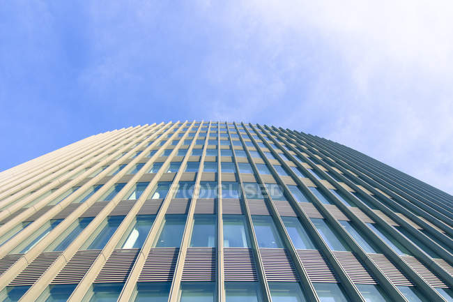 Germany, Berlin, office tower of Ernst and Young against sky — Stock Photo