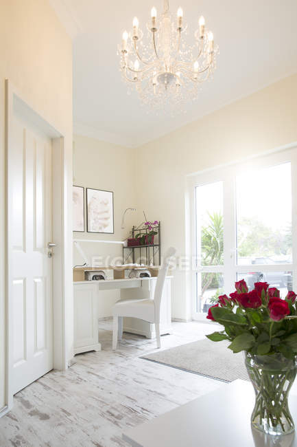 Work space at a white furnished bright room — Stock Photo