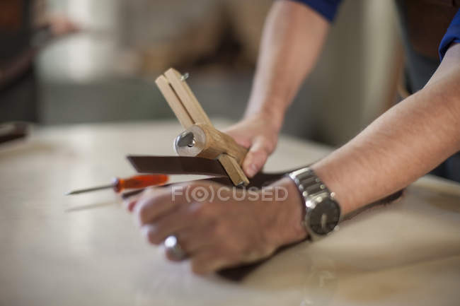 Closeup of man working in workshop — Stock Photo