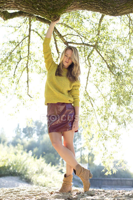 Young woman wearing knit pullover and mini skirt — Stock Photo