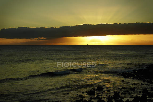 USA, Hawaii, sunset at the sea over water — Stock Photo