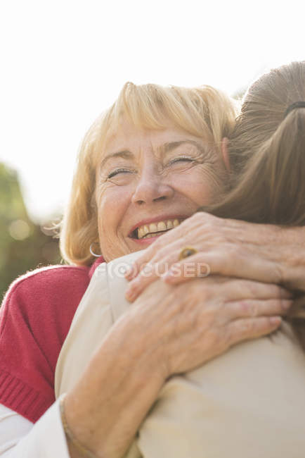 Portrait of happy senior woman hugging ger granddaughter — Stock Photo