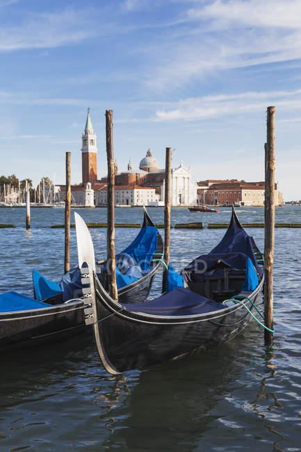 Italy, Veneto, Venice, View to Church San Giorgio Maggiore, Canale di San Marco and moored gondolas — Stock Photo