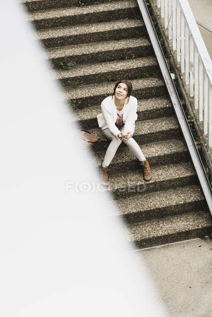 Woman sitting on staircase — Stock Photo