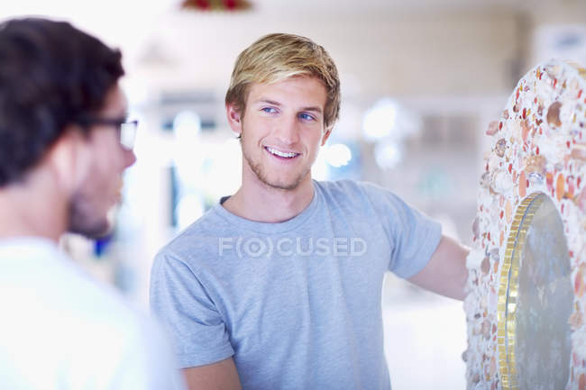 Two men in a stained glass salesroom — Stock Photo