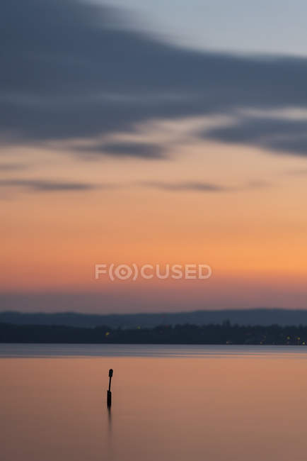 Germany, Baden-Wuerttemberg, Lake Constance, Meersburg, art installation sea mark at sunset — Stock Photo
