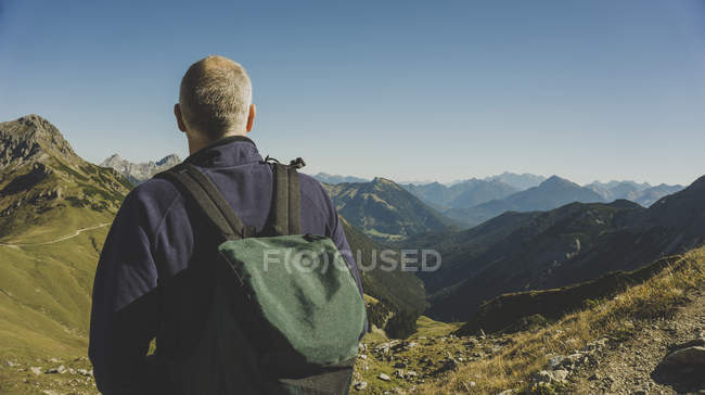 Austria, Tyrol, Tannheimer Tal, mature man hiking — Stock Photo