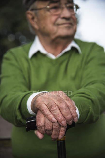 Senior man with walking stick — Stock Photo