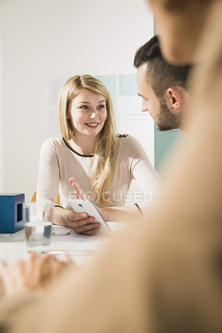 Young woman in a business meeting — Stock Photo
